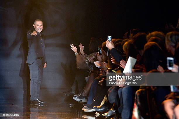 Designer Elie Saab acknowledges the applause of the public after his show as part of the Paris Fashion Week Womenswear Fall/Winter 2015/2016 on March...