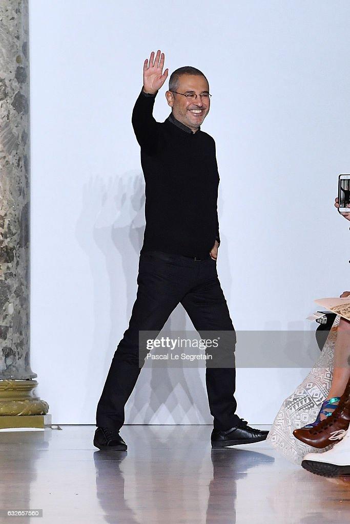 designer elie saab walks the runway during the elie saab spring summer show as part