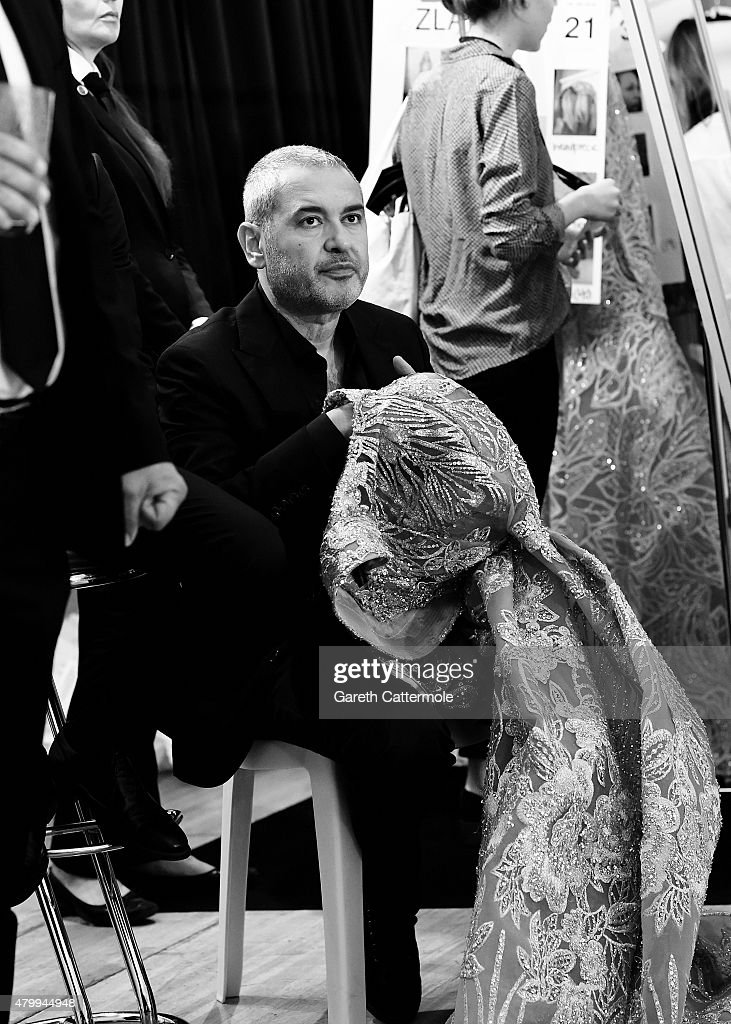 Designer <a gi-track='captionPersonalityLinkClicked' href=/galleries/search?phrase=Elie+Saab+-+Fashion+Designer&family=editorial&specificpeople=4979945 ng-click='$event.stopPropagation()'>Elie Saab</a> works backstage before his show as part of Paris Fashion Week Haute Couture Fall/Winter 2015/2016 on July 8, 2015 in Paris, France.