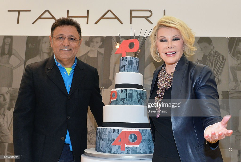 Designer Elie Tahari and TV personality <a gi-track='captionPersonalityLinkClicked' href=/galleries/search?phrase=Joan+Rivers&family=editorial&specificpeople=159403 ng-click='$event.stopPropagation()'>Joan Rivers</a> (R) attend New York City's Elie Tahari Day at Elie Tahari Pop-up Store on September 4, 2013 in New York City.