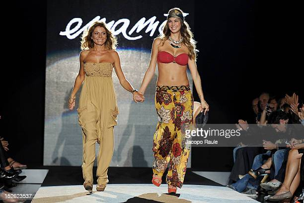 Designer Emanuela Corvo and Melissa Satta walk the runway at the Emamo Spring/Summer 2013 fashion show as part of Milan Womenswear Fashion Week on...