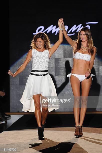 Designer Emanuela Corvo and Melissa Satta walk the runway at the Emamo fashion show as part of Milan Womenswear Fashion Week Spring/Summer 2014 on...