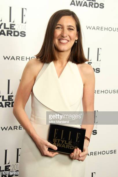Designer Emilia Wickstead winner of the Red Carpet Designer of the Year Award poses in the winners room at the Elle Style Awards 2014 at one...