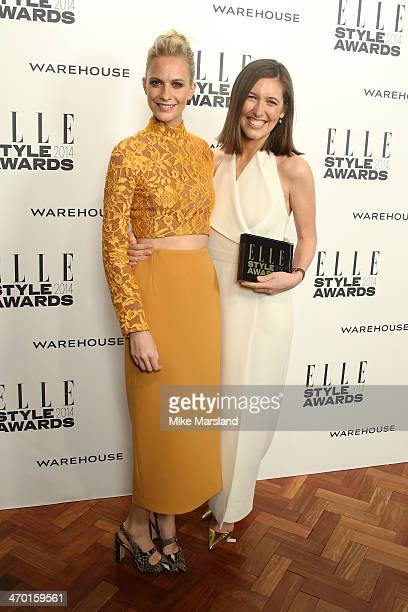 Designer Emilia Wickstead winner of the Red Carpet Designer of the Year Award poses in the winners room with Poppy Delevingne at the Elle Style...