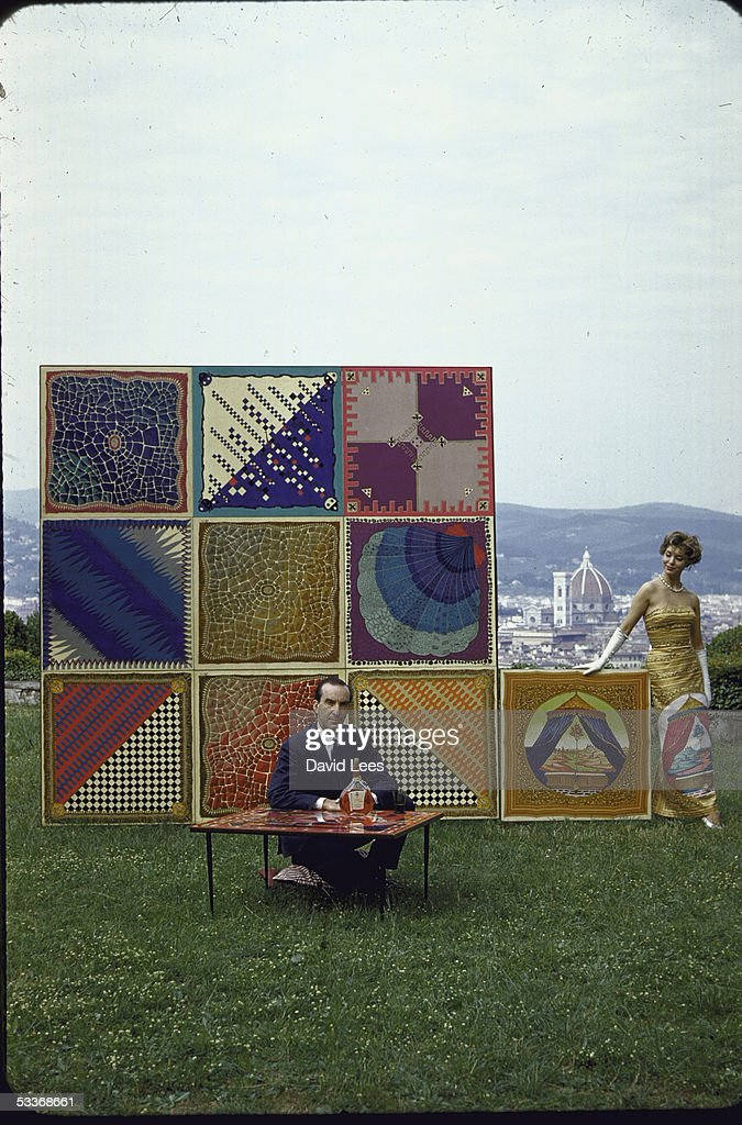 Designer Emilio Pucci sitting on lawn of his palazzo overlooking the city of Florence with table tops and evening dress his newest creations