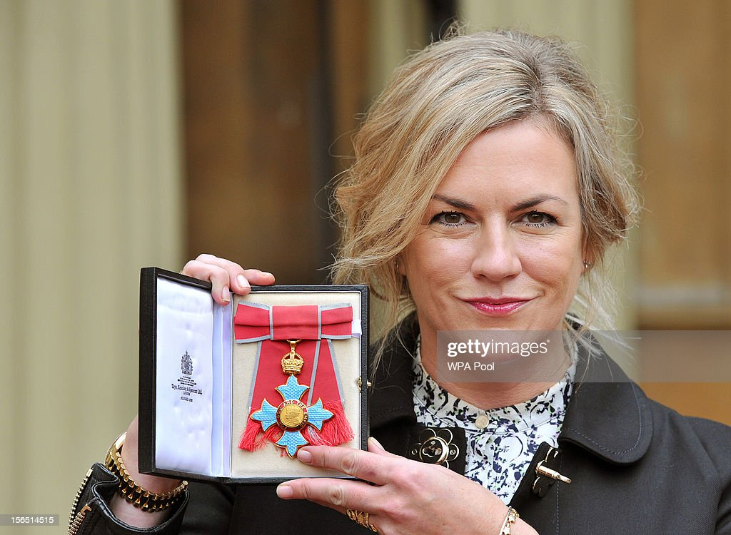 Designer Emma Hill proudly holds her Commander of the British Empire (CBE) after it was presented to her by Queen Elizabeth II, at the Investiture ceremony at Buckingham Palace on November 16, 2012 in London, England.