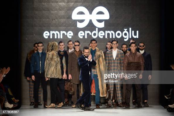 Designer Emre Erdemoglu and models pose his show as port of MBFWI presented by American Express Fall/Winter 2014 on March 11 2014 in Istanbul Turkey