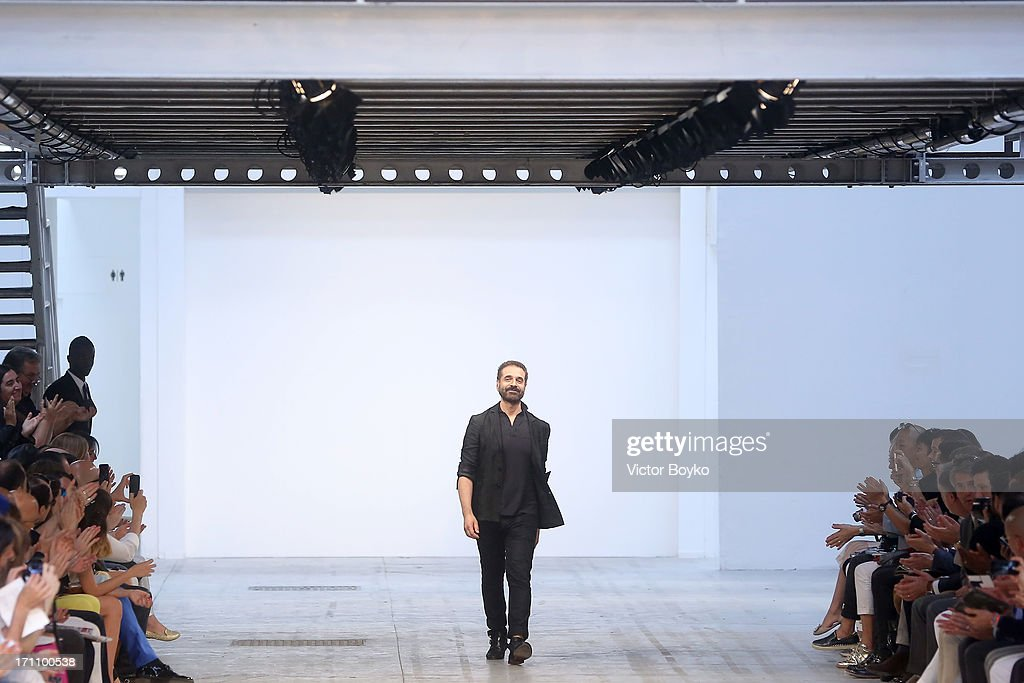 Designer <a gi-track='captionPersonalityLinkClicked' href=/galleries/search?phrase=Ennio+Capasa&family=editorial&specificpeople=4346403 ng-click='$event.stopPropagation()'>Ennio Capasa</a> acknowledges the applause of the audience after the Costume National Homme show during Milan Menswear Fashion Week Spring Summer 2014 on June 22, 2013 in Milan, Italy.