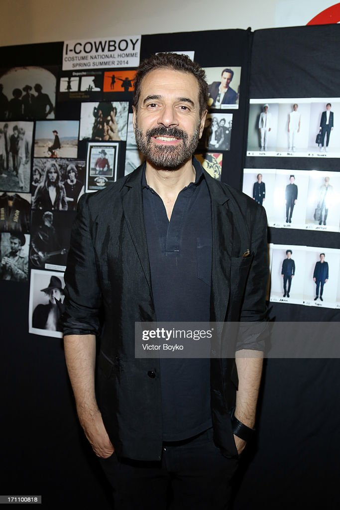 Designer Ennio Capasa attends backstage the Costume National Homme show during Milan Menswear Fashion Week Spring Summer 2014 on June 22, 2013 in Milan, Italy.