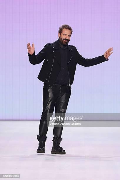 Designer Ennio Capasa walks the runway after the Costume National show during the MercedesBenz Fashion Days Zurich 2014 on November 14 2014 in Zurich...