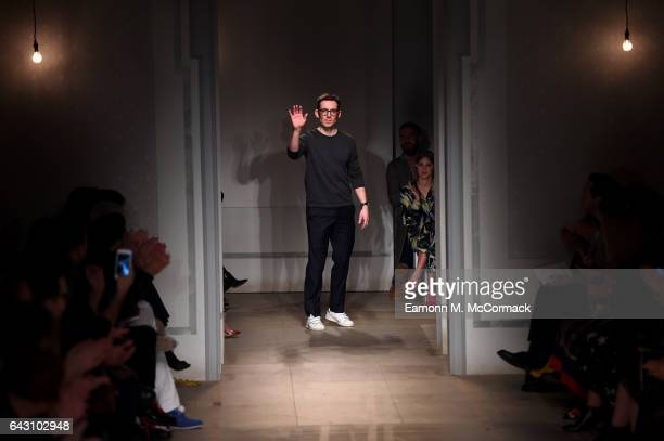 Designer Erdem Moralioglu salutes the crowd following the runway at the ERDEM show during the London Fashion Week February 2017 collections on...