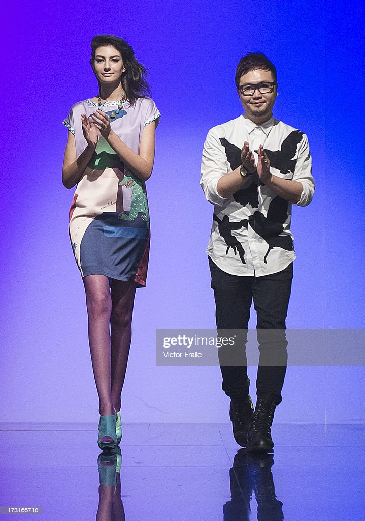 Designer Erick Cheung (R) of Hong Kong acknowledges on the runway during the Designer Collection Show on day 2 of Hong Kong Fashion Week Spring/Summer 2013 at the Hong Kong Convention and Exhibition Centre on July 9, 2013 in Hong Kong, China.