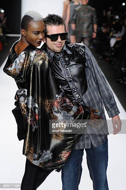 Designer Erik 'Mister Triple X' Rosete and a model walk the runway at the FLT Moda Art Hearts Fashion show presented by AIDS Healthcare Foundation...