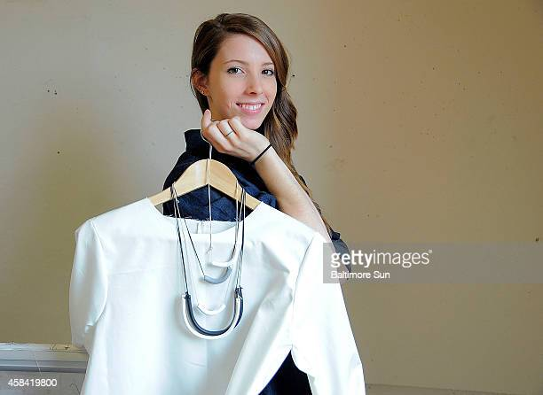 Designer Erin Sudeck poses for a portrait with her Poplin popover with a U necklace and U baby pendant