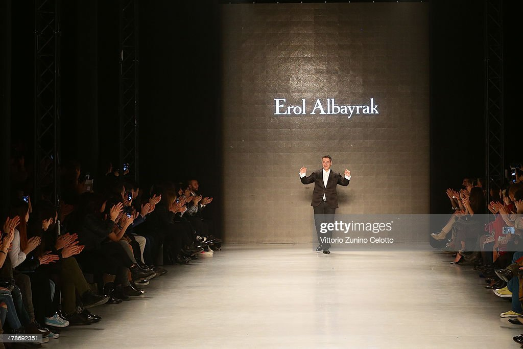 Designer Erol Albayrak walks the runway after his show during MBFWI presented by American Express Fall/Winter 2014 on March 14, 2014 in Istanbul, Turkey.
