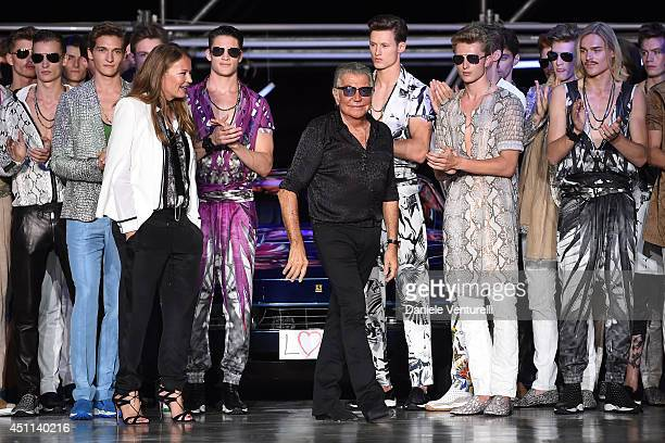 Designer Eva Cavalli and Roberto Cavalli acknowledge the applause of the audience after the Roberto Cavalli show as part of Milan Fashion Week...