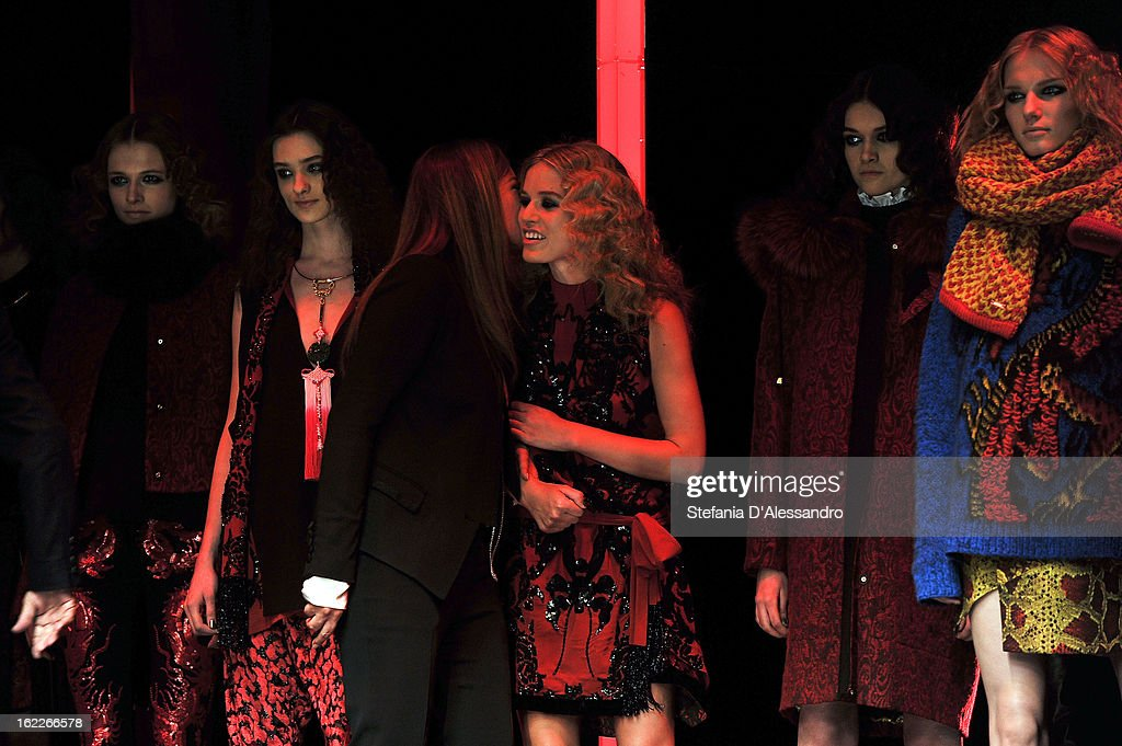 Designer <a gi-track='captionPersonalityLinkClicked' href=/galleries/search?phrase=Eva+Cavalli&family=editorial&specificpeople=1719408 ng-click='$event.stopPropagation()'>Eva Cavalli</a> (C-L) is congratulated by model Georgia May Jagger (C-R) and her other models as she acknowledges the applause of the audience after the Just Cavalli fashion show during Milan Fashion Week Womenswear Fall/Winter 2013/14 on February 21, 2013 in Milan, Italy.
