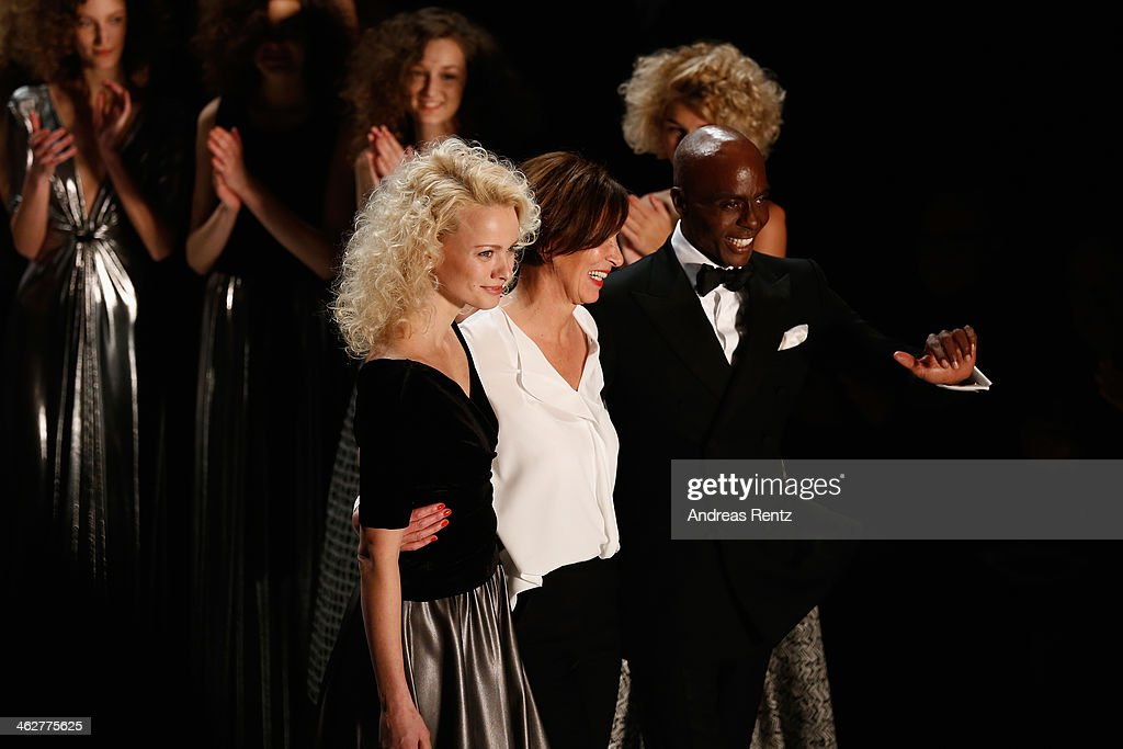 Designer Eva Lutz acknowledges the audience with Franziska Knuppe and Bruce Darnell after the Minx by Eva Lutz show during MercedesBenz Fashion Week...