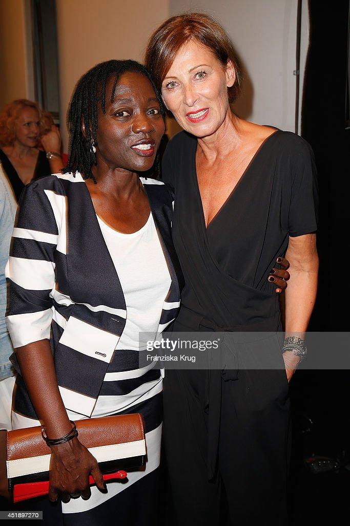 Designer Eva Lutz and Auma Obama attend the Minx by Eva Lutz show during the MercedesBenz Fashion Week Spring/Summer 2015 at Erika Hess Eisstadion on...