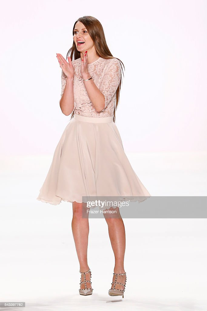 Deisgner Ewa Herzog acknowledges the applause of the audience at the Ewa Herzog show during the Mercedes-Benz Fashion Week Berlin Spring/Summer 2017 at Erika Hess Eisstadion on June 28, 2016 in Berlin, Germany.
