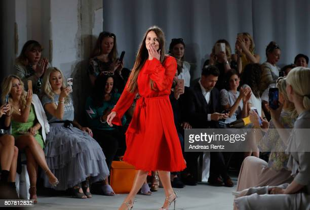 Designer Ewa Herzog acknowledges the applause of the audience at the Ewa Herzog show during the MercedesBenz Fashion Week Berlin Spring/Summer 2018...