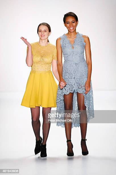 Designer Ewa Herzog and a model walk the runway at the Ewa Herzog show during the MercedesBenz Fashion Week Berlin Autumn/Winter 2015/16 at...