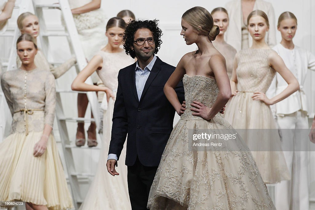 Designer Fadi El Khoury gestures during the Fadi El Khoury S/S 2013 Fashion Show at the Mercedes-Benz Stockholm Fashion Week on August 27, 2012 in Stockholm, Sweden.