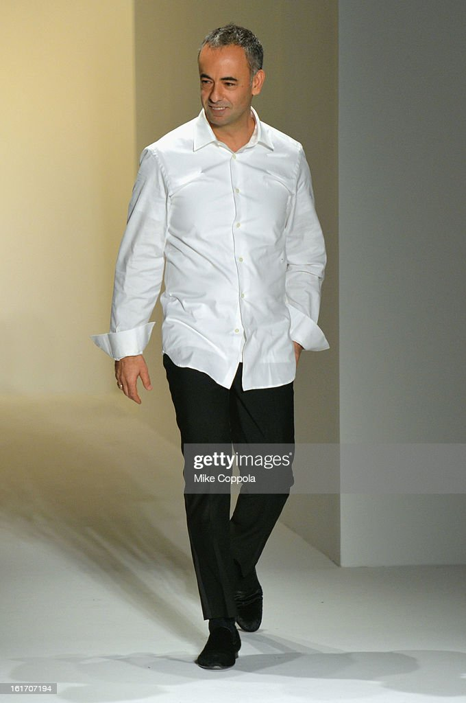 Designer Fancisco Costa walks the runway at the Calvin Klein Collection Fall 2013 fashion show during Mercedes-Benz Fashion Week at 205 West 39th Street on February 14, 2013 in New York City.