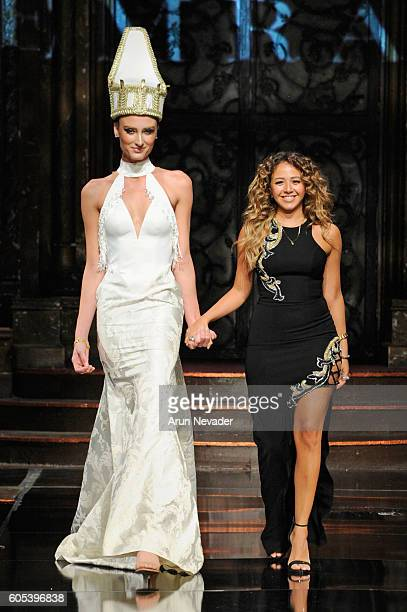 Designer Farida Temraz walks the runway with a model wearing Temraza at Art Hearts Fashion NYFW The Shows presented by AIDS Healthcare Foundation at...