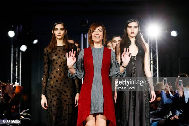 Designer Fatima Lopes walks the runway with models during the Fatima Lopes show as part of the Paris Fashion Week Womenswear Fall/Winter 2017/2018 on...