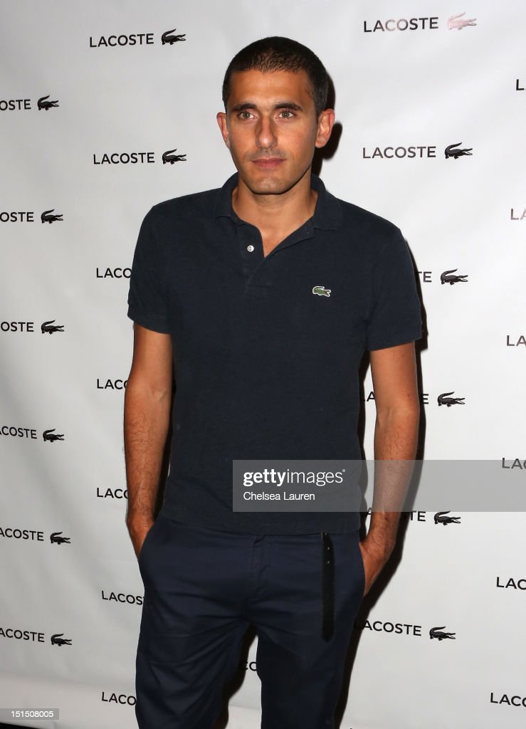 Designer Felipe Oliveira Baptista poses backstage at the Lacoste Spring 2013 fashion show during Mercedes-Benz Fashion Week at The Theatre, Lincoln Center on September 8, 2012 in New York City.
