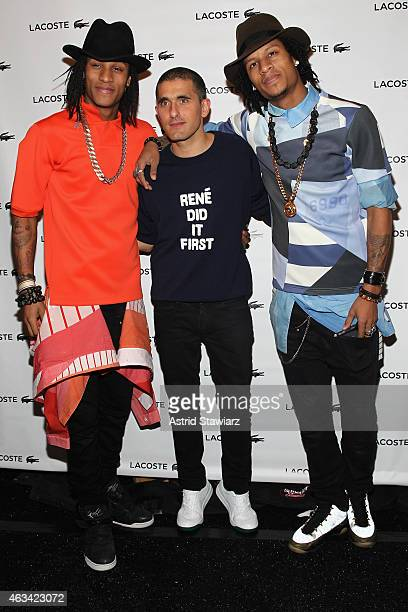 Designer Felipe Oliveira Baptista poses with dancers Larry Bourgeois and Laurent Bourgeois of Les Twins backstage at the Lacoste fashion show during...