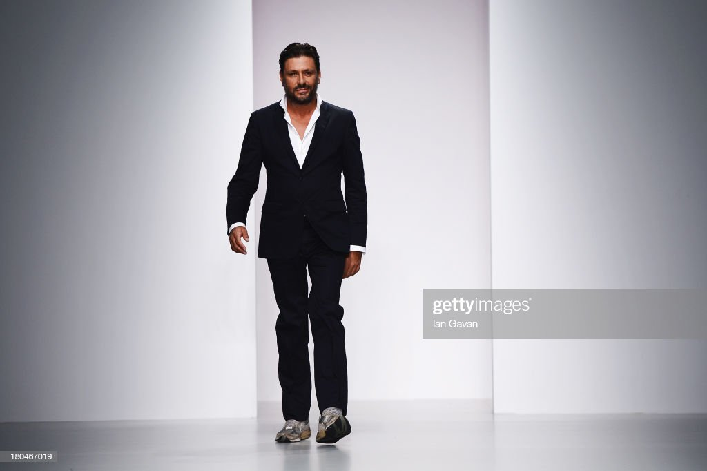 Designer Filippo Scuffi acknowledges the audience after the DAKS show during London Fashion Week SS14 at BFC Courtyard Showspace on September 13, 2013 in London, England.