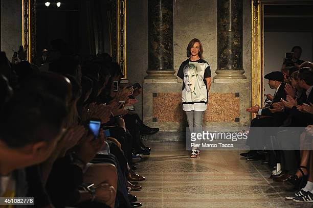 Designer Fiona Cibani acknowledges the applause of the public after the Ports 1961 show as part of Milan Fashion Week Menswear Spring/Summer 2015 on...