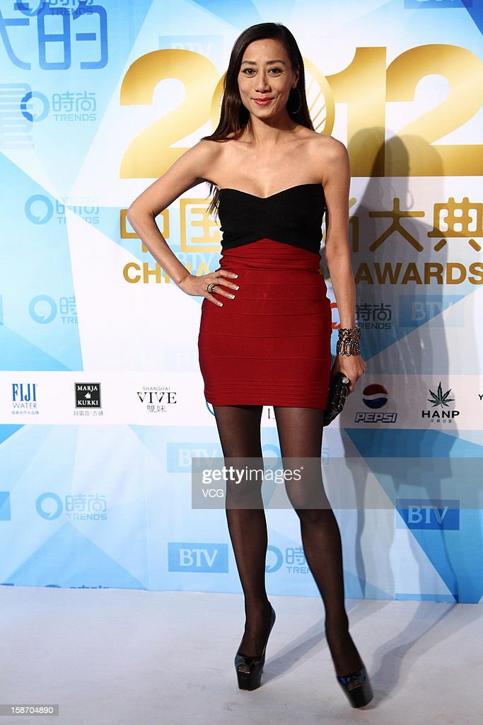 Designer Flora Cheung arrives at the red carpet of the 2012 China Trends Awards at BTV Grand Theater on December 22, 2012 in Beijing, China.
