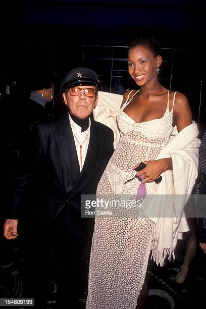 Designer Francesco Scavullo and model Beverly Peele attend A Night of Fun and Sun Absolut Vodka Party on April 3 1993 at the Supper Club in New York...