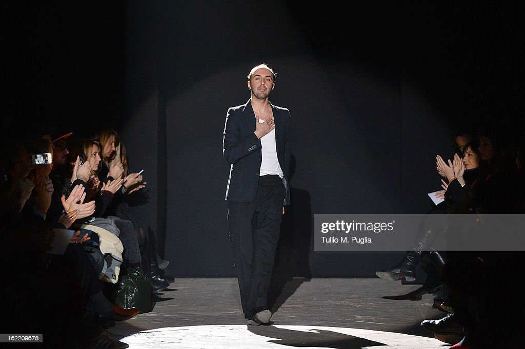 Designer Francesco Scognamiglio acknowledges the applause of the pubblic at the Francesco Scognamiglio fashion show as part of Milan Fashion Week...