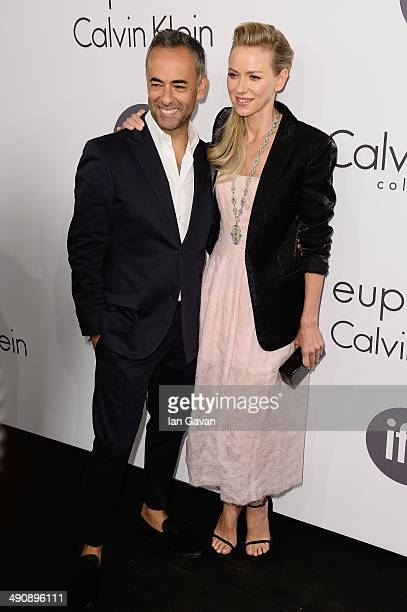 Designer Francisco Costa and actress Naomi Watts attend the Calvin Klein party during the 67th Annual Cannes Film Festival on May 15 2014 in Cannes...