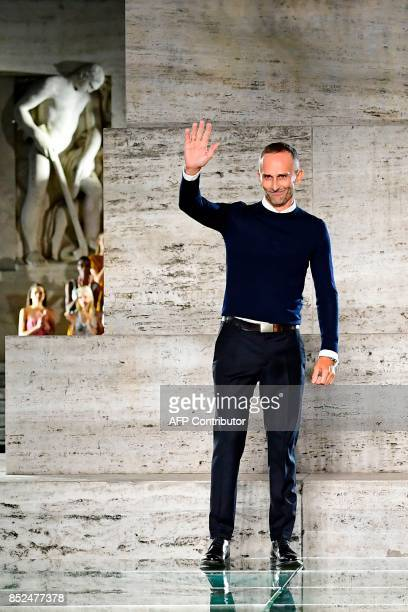 Designer Fulvio Rigoni greets the audience at the end of the show for fashion house Salvatore Ferragamo during the Women's Spring/Summer 2018 fashion...