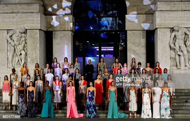 Designer Fulvio Rigoni poses with models at the end of the show for fashion house Salvatore Ferragamo during the Women's Spring/Summer 2018 fashion...