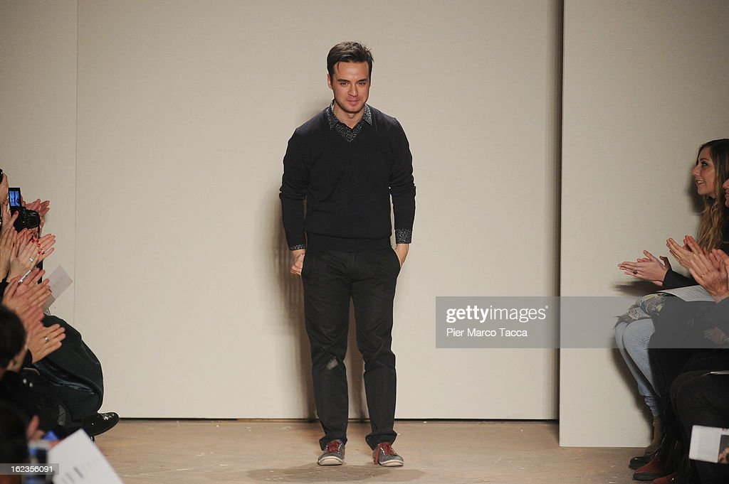 Designer Gabriele Colangelo acknowledges the applause of the audience at the Gabriele Colangelo fashion show during Milan Fashion Week Womenswear Fall/Winter 2013/14 on February 22, 2013 in Milan, Italy.