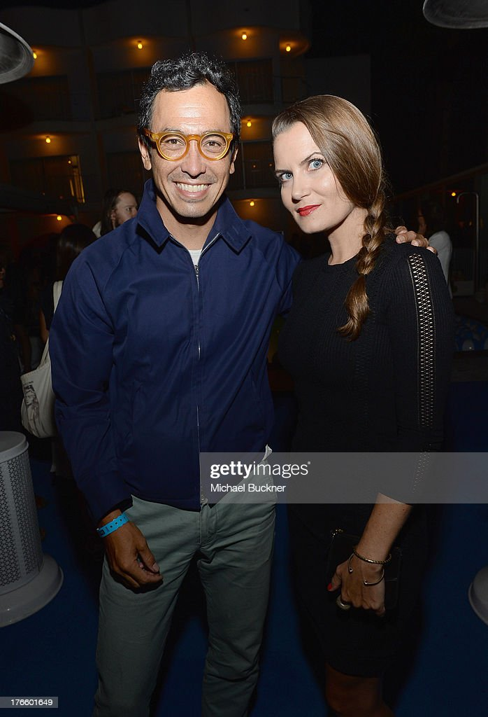 Designer Geoff McFetridge (L) and Jenni Boelkens attend Warby Parker's store opening in The Standard, Hollywood on August 15, 2013 in Los Angeles, California.
