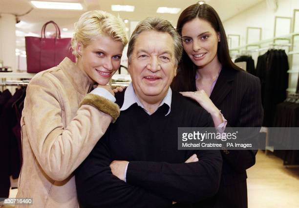 Designer George Davies flanked by two models during a photocall at the Marks Spencer's store in Marble Arch London where his exclusive per una...