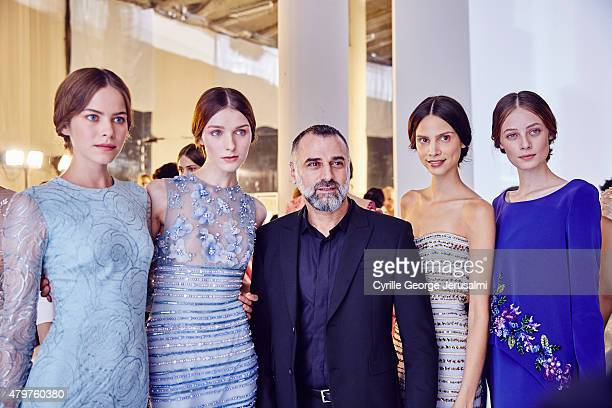 Designer George Hobeika poses backstage with models after the George Hobeika show as part of Paris Fashion Week Haute Couture Fall/Winter 2015/2016...