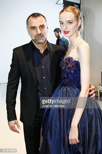 Designer Georges Hobeika and a model pose backstage after the Georges Hobeika show as part of Paris Fashion Week Haute Couture Fall/Winter 20142015...
