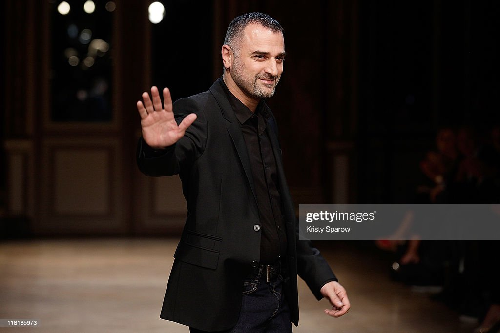 Designer <a gi-track='captionPersonalityLinkClicked' href=/galleries/search?phrase=Georges+Hobeika+-+Fashion+Designer&family=editorial&specificpeople=13871973 ng-click='$event.stopPropagation()'>Georges Hobeika</a> walks the runway during the <a gi-track='captionPersonalityLinkClicked' href=/galleries/search?phrase=Georges+Hobeika+-+Fashion+Designer&family=editorial&specificpeople=13871973 ng-click='$event.stopPropagation()'>Georges Hobeika</a> Haute Couture Fall/Winter 2011/2012 show as part of Paris Fashion Week at Hotel Westin on July 4, 2011 in Paris, France.