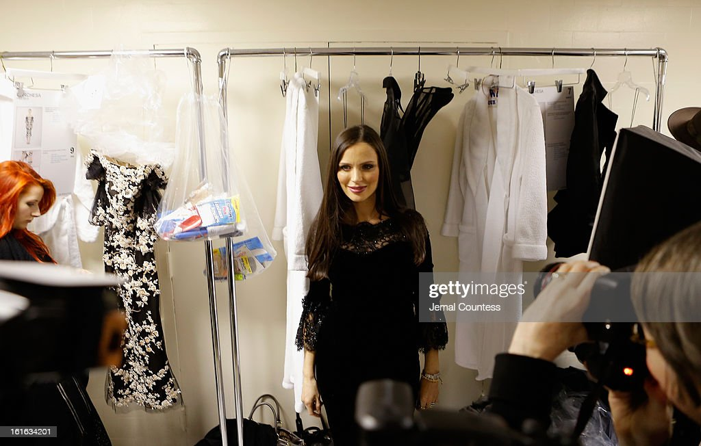 Designer Georgina Chapman prepares backstage at the Marchesa Fall 2013 fashion show during Mercedes-Benz Fashion Week at The New York Public Library on February 13, 2013 in New York City.