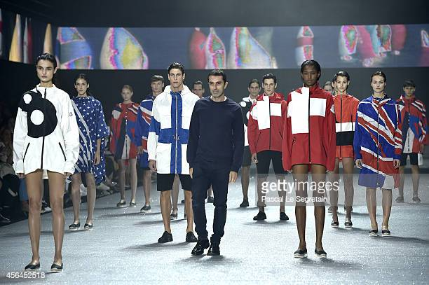 Designer Giambattista Valli acknowldges the applause of the public after the Moncler Gamme Rouge show as part of the Paris Fashion Week Womenswear...