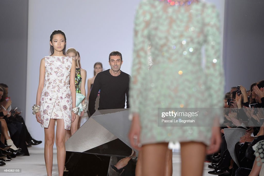 Designer Giambattista Valli acknowledges the applause of the audience after his show as part of Paris Fashion Week Haute Couture Spring/Summer 2014 on January 20, 2014 in Paris, France.