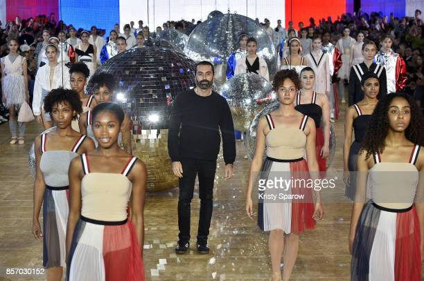 Designer Giambattista Valli acknowledges the audience during the Moncler Gamme Rouge show as part of Paris Fashion Week Womenswear Spring/Summer 2018...